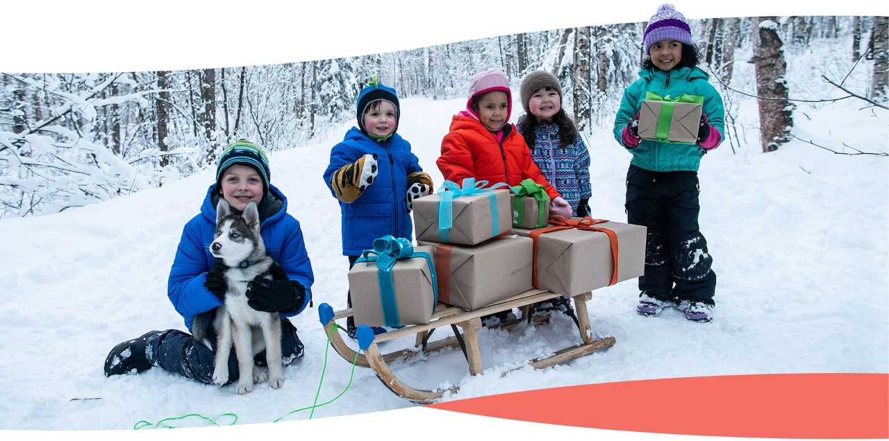 Kids with Dog Sled and Gifts