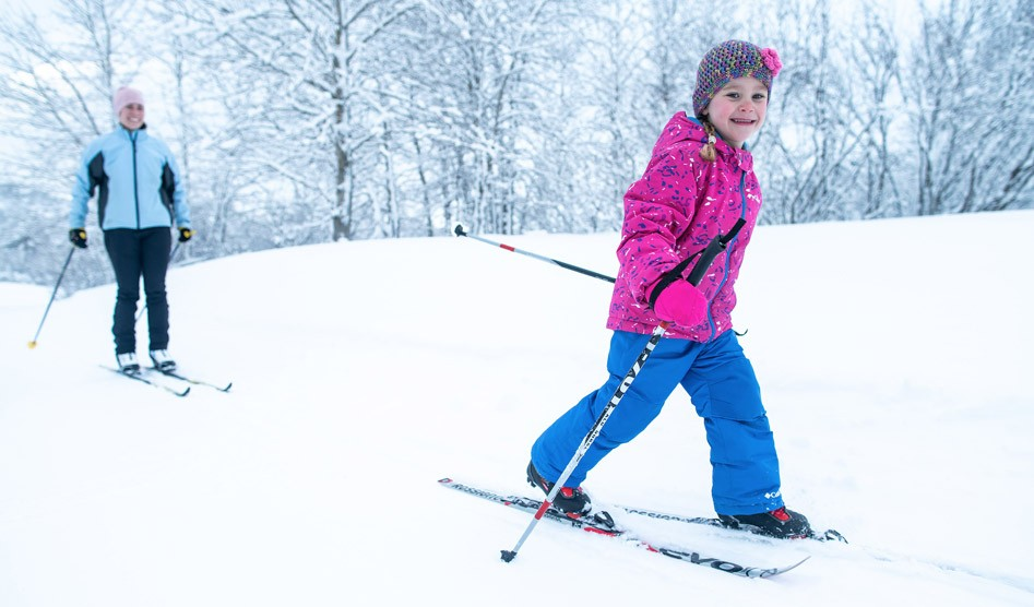 Girl and Mom Cross Country Skiing